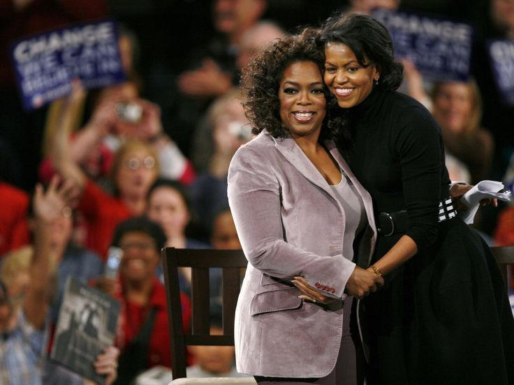 Michelle Obama, wife of Democratic presidential hopeful, Sen. Barack Obama, D-Ill., gets a hug from Oprah Winfrey, during a rally, Saturday, Dec. 8, 2007, in Des Moines, Iowa.