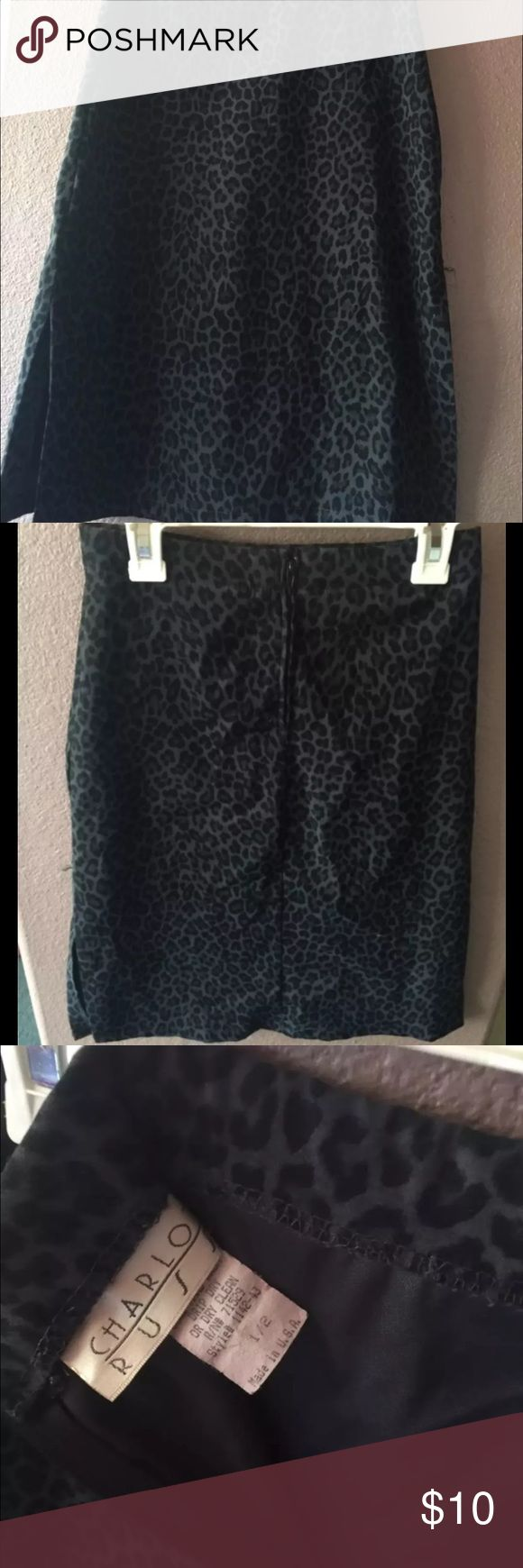 Cute Skirt!! Good for work or any business casual affair, gently worn pencil skirt. Has slits on both sides. Base color is charcoal gray with black animal print. Charlotte Ruse brand size 1/2. Bundle and save. Thank you for looking 🌸 Skirts Pencil