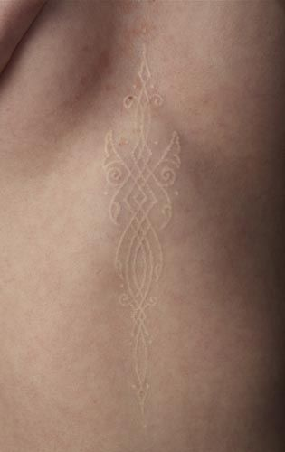 Watson Adkinson; white ink tattoos are so much more discreet than black ink ones, but sometimes they do seem like scars. I find that rather interesting.