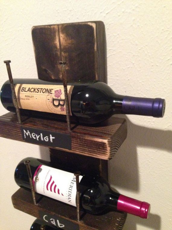 This wine rack holds 5 standard* size bottles of wine and is 38 x 10. It is covered in a Dark Walnut stain. The fronts can be painted with chalkboard paint so that you can label the types of wine you have, or can also order one without the chalkboard paint added. Included in your