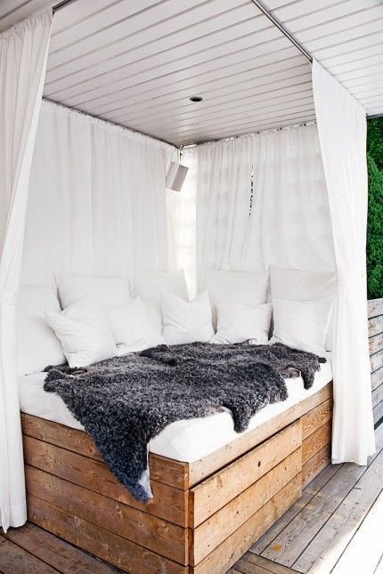 Take resting in the shade to a whole new level by building an outdoor bed, and install a poolside outdoor shower.  A perfect way to  bring night life a notch; great for outside socializing or as a camp-out spot on hot summer nights. | By Amelie Grönholm/ Photo Katarina Malmstrom