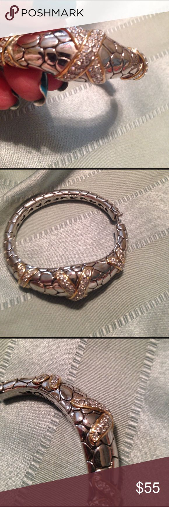 Faux John Hardy bracelet. This is a copy of John Hardy's Cali Collection.  Gorgeous and looks like the real deal. It is gold and silver with faux diamonds. Jewelry Bracelets