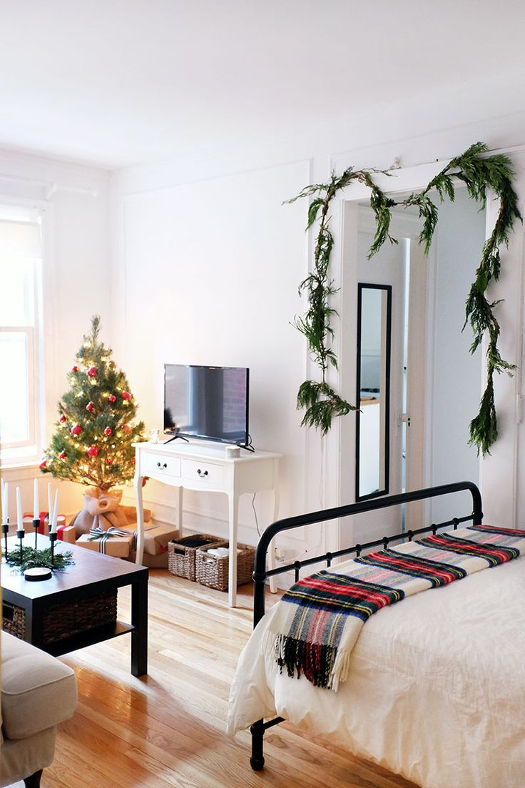 studio apartment | holiday decorating on a budget | studio apartment layout | how to decorate studio apartment | small space decorating | small space decorating for the holidays | garland | christmas tree | TV styling