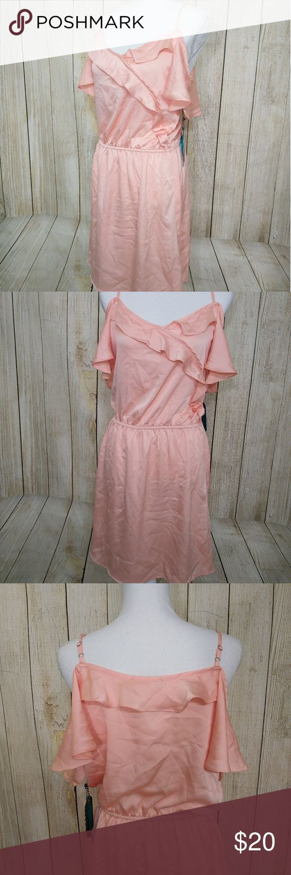 NWT Salmon Peach Colored Cold Shoulder Dress Beautiful cold shoulder light peach colored dress. New with tags. Most Collection Dresses Midi