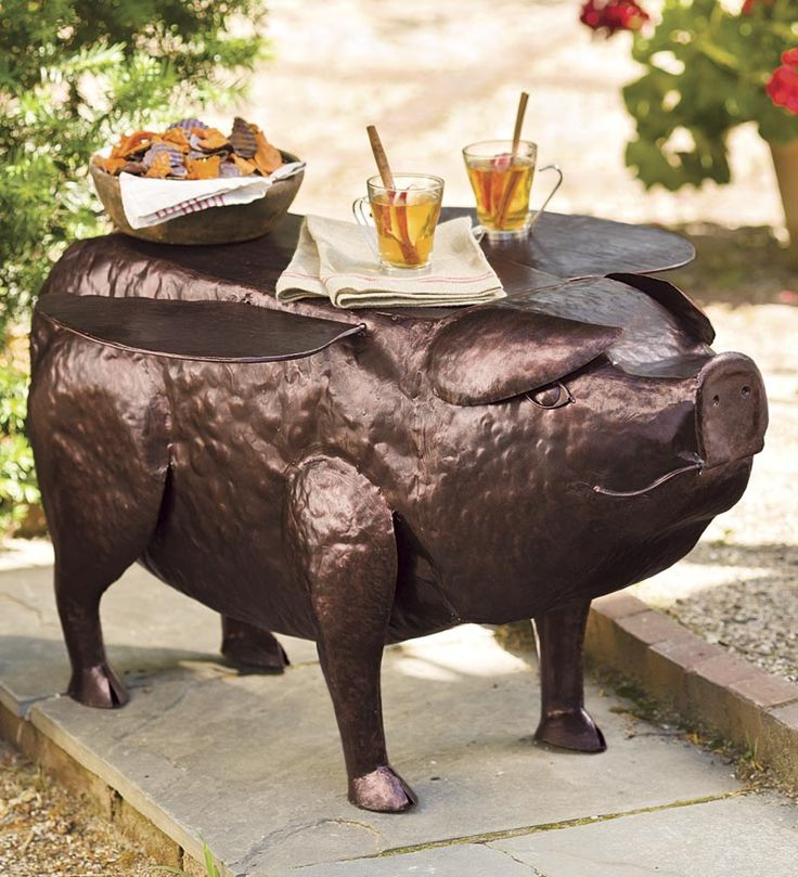 """Pigasus"" the Flying Pig Side Table is handcrafted from recycled metal. What a porker! And a great conversation piece :)"