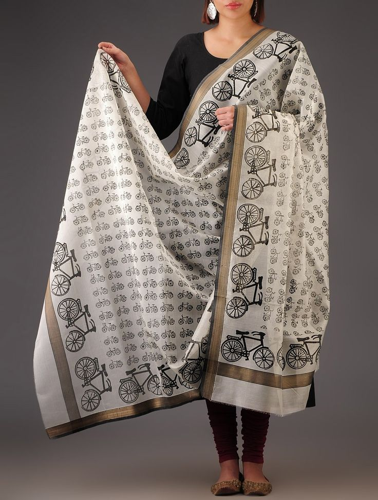 White-Black Maheshwari Cotton Silk Block Printed Handwoven Dupatta A Maheshwari cotton silk dupatta, this has been block printed with nature inspired motifs and patterns. A product of Kavita Sanghis Khoj, this has been handwoven by rural artisans of India. Pair it with oxidized silver or antique gold jewelry for an ethnic look.