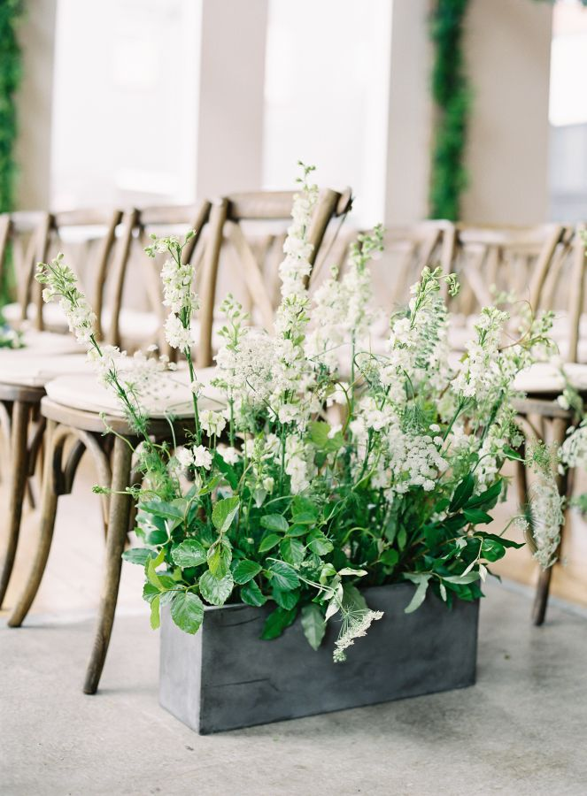 Organic garden flowers down the aisle: http://www.stylemepretty.com/2017/01/04/urban-garden-seattle-wedding/ Photography: O'Malley Photographers - http://omalleyphotographers.com/