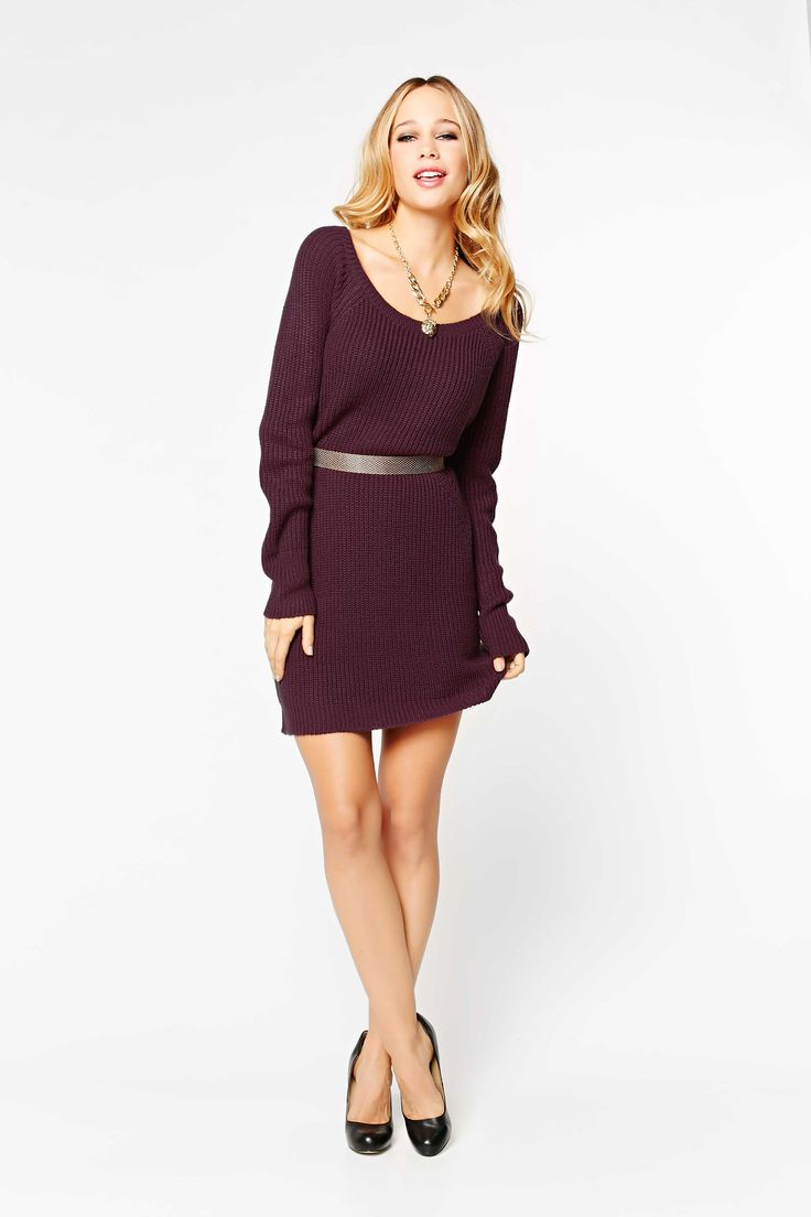Cozy and sexy! This sweater dress looks gorgeous paired with a belt and knee high boots.