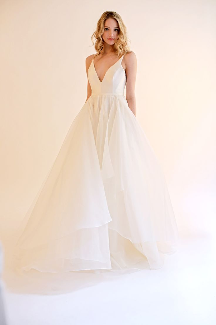 The Gabrielle is an Ivory silk deep V-neck gown with an open back.