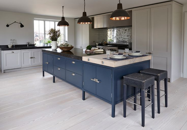 Transitional Kitchen by Mowlem & Co. Pale gray cabinets with a rich indigo island.