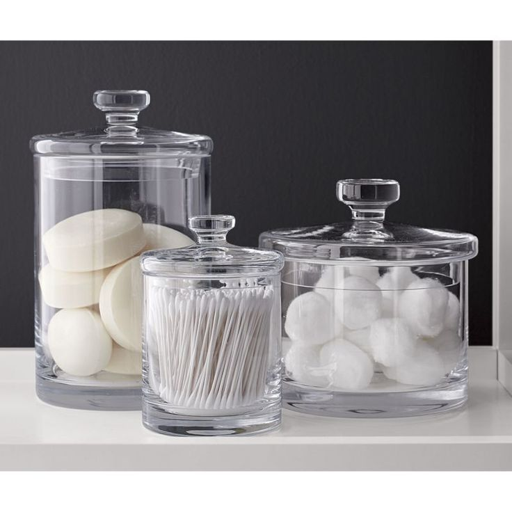 Simple bathroom storage with a retro feel.  Handmade glass canisters with nesting lids update a classic apothecary look. Handmade glassCut and polished rimHand wash for best resultsMade in Poland.