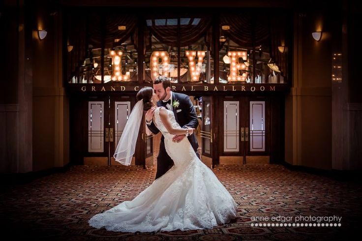 Lovely Kiss in front of Liuna Station's Grand Central Ballroom. Hamilton, Ontario. Photo Credit: Anne Edgar Photography