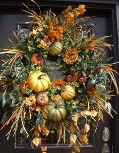 Pumpkin Wreath, XL Fall Wreaths, Fall Wreath, Elegant Fall Decor, Thanksgiving Wreath  Fall Bounty  My version of a cornucopia wreath. Pumpkins were certainly on my mind for this piece. The backdrop is exciting & layered in so many types of greenery. Full of pumpkins & gourds in shades of gold, green, & pumpkin spice. This is a big & heavy wreath. It will fill a standard sized door completely width wise. This size is ideal for oversize doors.  Designer wreath that is skillfully constructed…