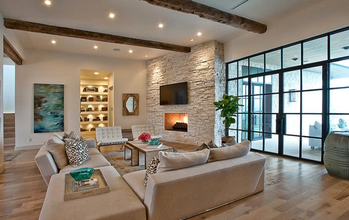 House of Turquoise: Glynis Wood Interiors  exposed wood beams, rock fireplace, neutral furniture, large windows
