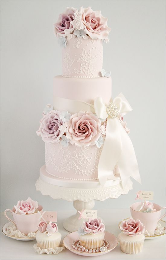 So perfect for a vintage inspired tea party wedding with a color palette of soft pink and muted purples. We especially love the cupcake display below the cake.Maybe not so many flowers, but I like it.