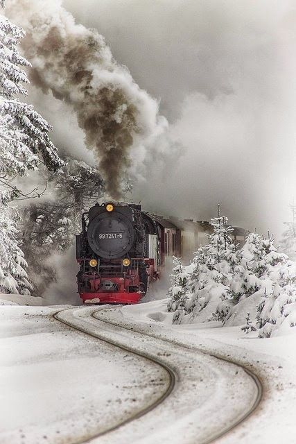 Choo-Choo...she'll be coming around the mountain when she comes!   This is a spectacular pix of old steam train.