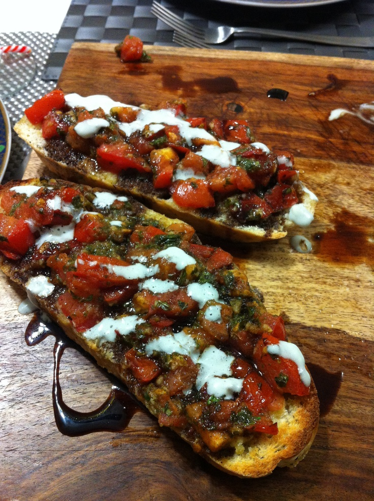 Bruschetta with balsamic glaze and blue cheese drizzle