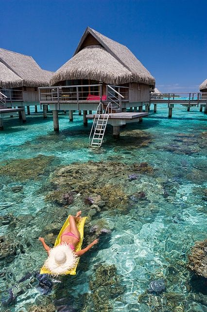 * French Polynesia, Moorea, Woman sunbathing and relaxing floating on tropical water daydreaming #travel