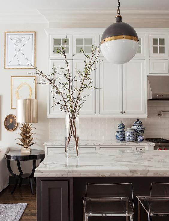 Black Kitchen island with CB2 Vapor Counter Stools and Hicks Pendant