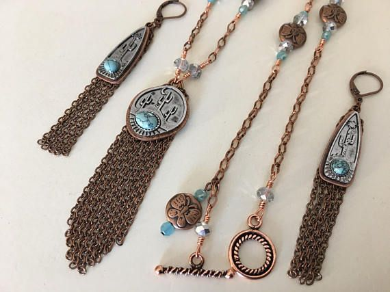 This uniquely handcrafted extra long necklace set from Simply Charmed Jewelry is an original creation. It has the western feel with the Cactus in silver and a touch of aqua! It's got lots of dangle with the copper wire to dangle down. I trailed lots of copper butterfly spacers