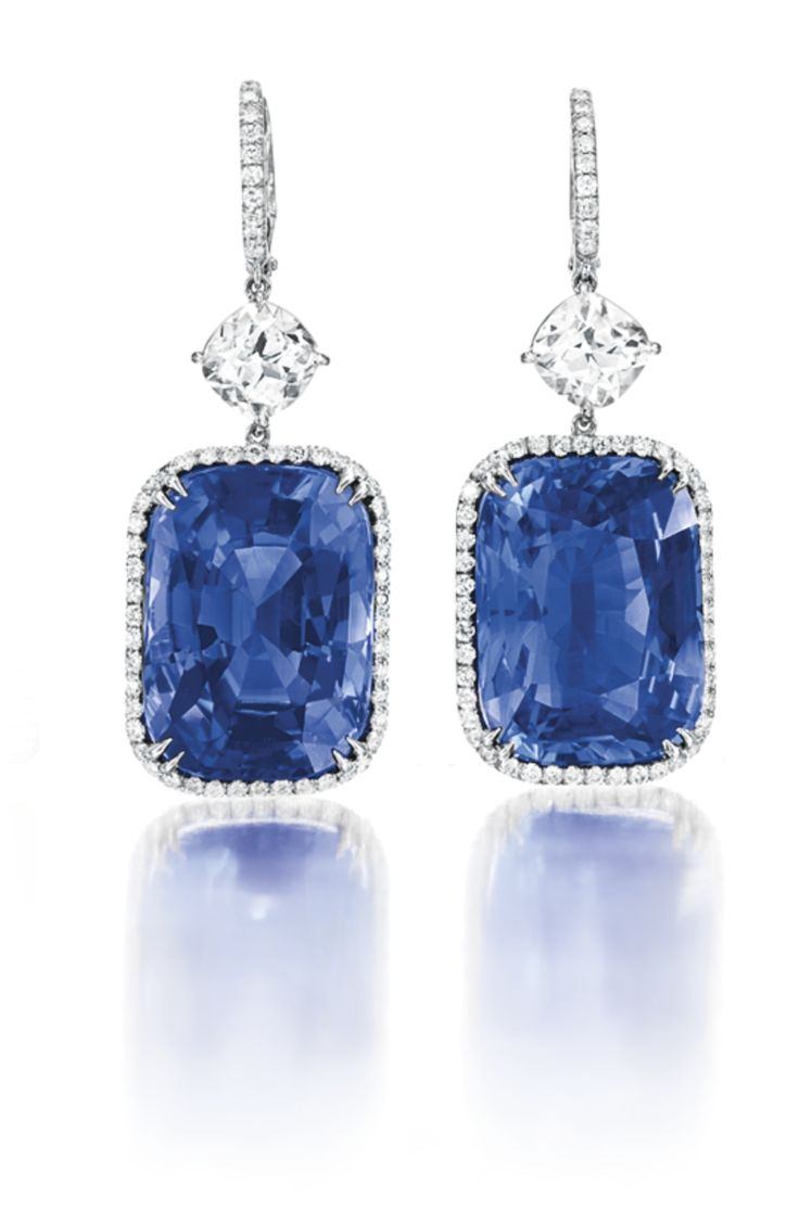 A Pair of Sapphire and Diamond Ear Pendants Each set with a cushion-cut sapphire, weighing approximately 20.82 and 17.42 carats, to the circular-cut diamond surround and gallery, from a cushion-cut diamond, weighing approximately 1.08 and 1.06 carats, to the circular-cut diamond French wire, mounted in platinum