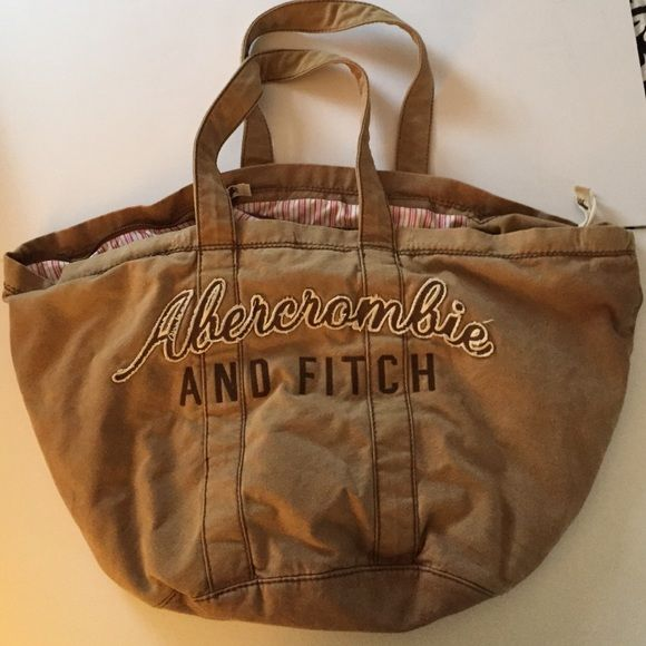Abercrombie and Fitch Tote brown Abercrombie And Fitch Brown Tote. This tote fits everything great for travel, long weekend and to take to the beach. 2 side zip pockets that reach to the bottom of he bag. Extremely clean inside and out. Smoke Free Home. Abercrombie & Fitch Bags Totes