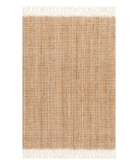 Embolden a room simply by adding a layer under your feet with this luxurious rug that provides texture and style.