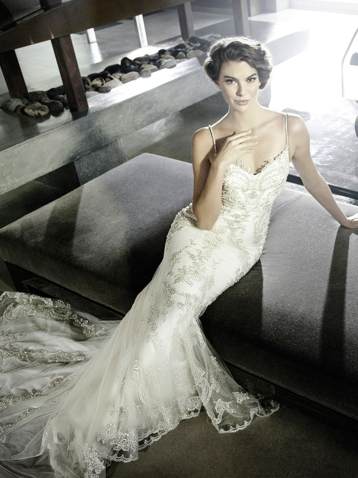 Beautiful Henley by Enzoani features a tulle mermaid gown with a soft sweetheart neckline beaded straps beaded embroidered bodice and stunning scalloped V back