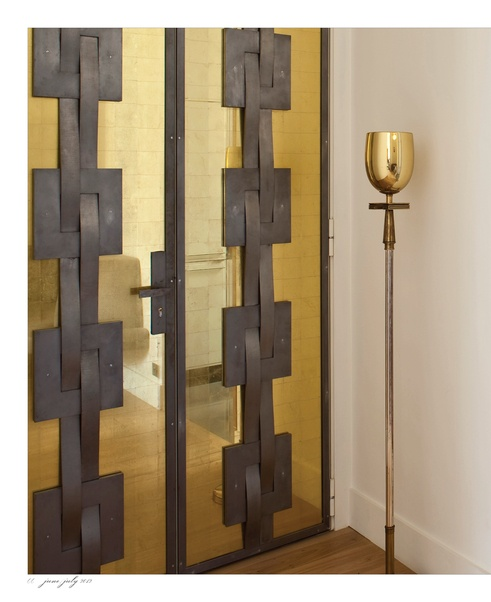 Make An Entrance. Wrought iron and mirrored glass doors. Interior Designer: Pierre Yovanovitch.
