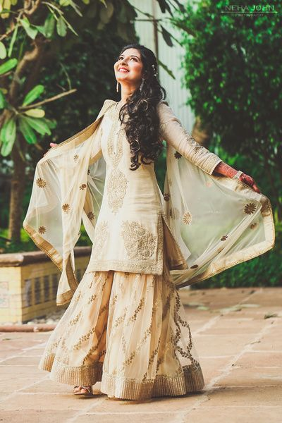 Mehendi Outfits - Beige and Gold Sharara | WedMeGood #wedmegood #indianbride #indianwedding #sharara #gold #indianoutfit #mehendioutfit