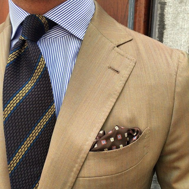 Beige jacket, white shirt with navy dress stripes, brown tie with blue & yellow stripes