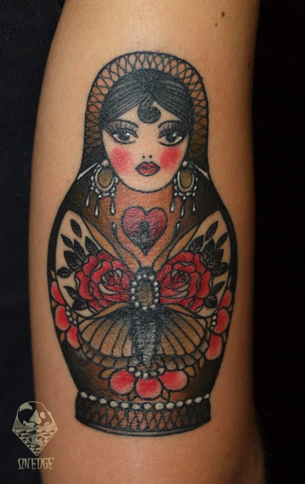 I really like the butterfly on her belly but I don't like the shape of her head