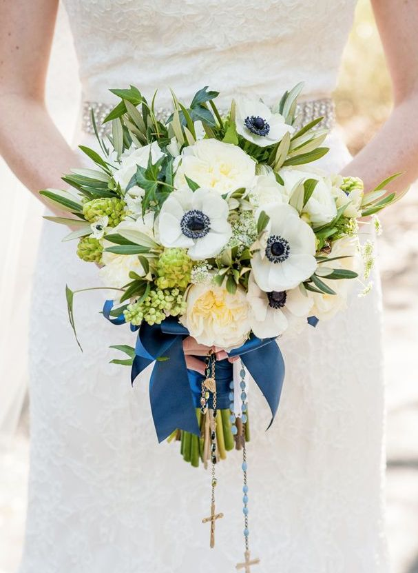 Gorgeous wedding bouquet with blue ribbon