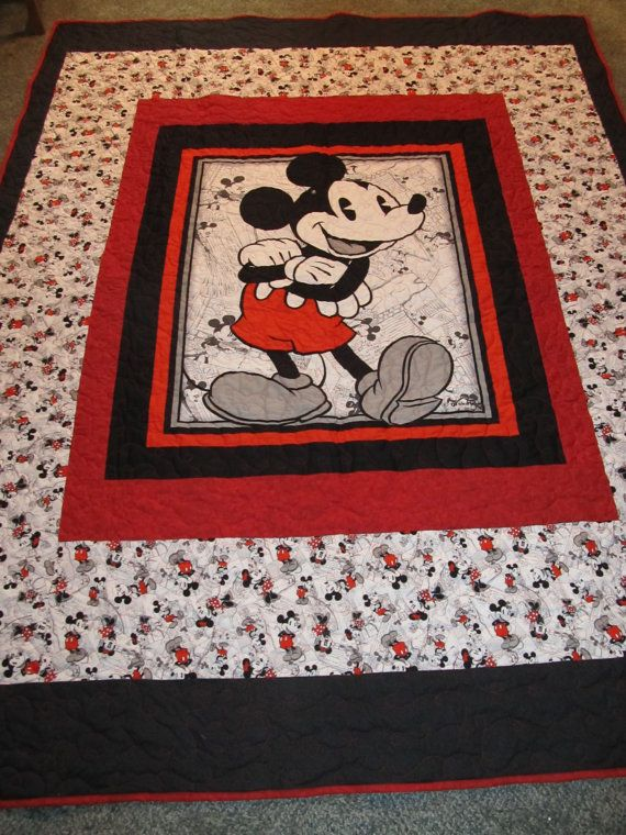 This Mickey Mouse Quilt will fit a Twin size bed. It is adorable with Mickey done in reds and blacks and matching panel and bordered with Matching Mickey Fabric.    The back is done in a black and white fabric with leaves and Black fabric to match the front black.(See pictures to see picture)    The quilt is done with all Cotton Fabrics. The size is 68 x 87. A great size for a Twin Bed. All Mickey and Disney Lovers will fall in love with this quilt.    It is quilted on a long arm Machine in…