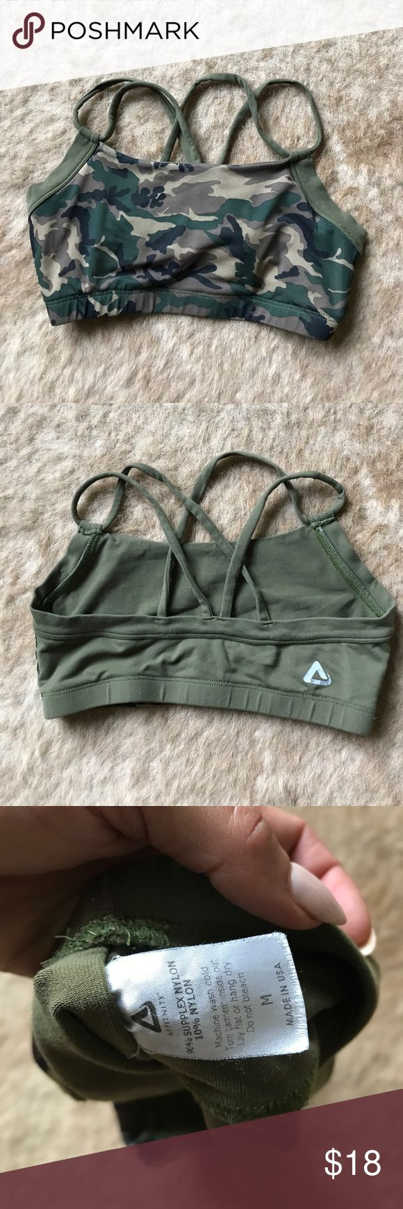 Affinity Camo Green Strappy sports bra size medium Affinity bra clothing is perfect fitness photo shoot quality clothing that can also stand up to functional training. This camo bra has been for for some shoots and minimal training. Gently used but no signs of pilling on fabric and color is still very vibrant for photos. Affinity Tops Tank Tops