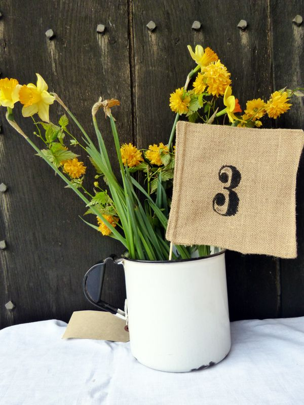 Hessian Wedding Table Numbers - The Vintage Bunting Hire Company £4.00 each Available from http://www.thevintagebuntinghirecompany.com Copyright protected.