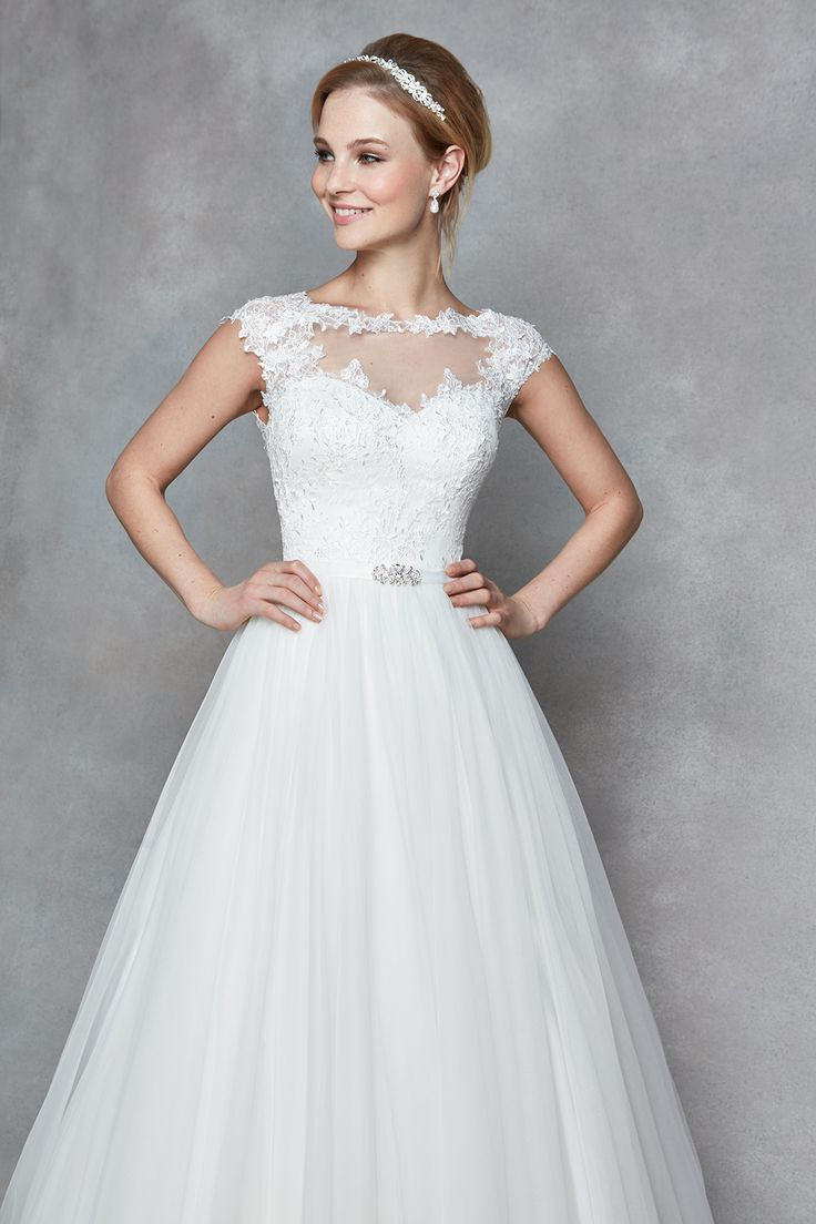 Illusion tulle, buttons and delicate lace appliqué... What more could a girl want? 'Celeste' by Anna Sorrano is an absolute stunning choice for your weddingIs this 'the one' for you?