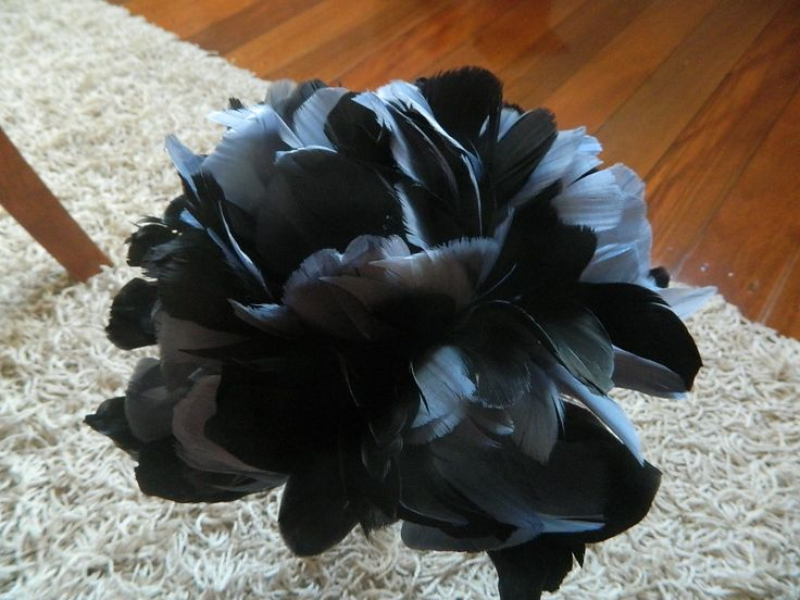 Feather tulip bouquet, Stunning charcoal and black. Prices, Small $160, medium $190, and $240 for the large . www.floralproductions.com.au #black,#blackfeather, #wedding,