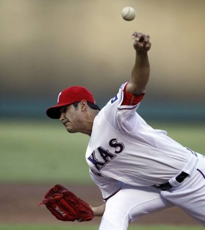 Texas starting pitcher Martin Perez throws a second-inning pitch during the Boston Red Sox vs. the Texas Rangers major league baseball game at Rangers Ballpark in Arlington on Tuesday, July 24, 2012.
