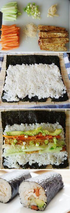 Vegan Sushi Rolls - sticky rice, baked tofu, avocado, carrot, cucumber, spring onion, sesame seeds, pickled ginger & teriyaki sauce, wrapped in nori