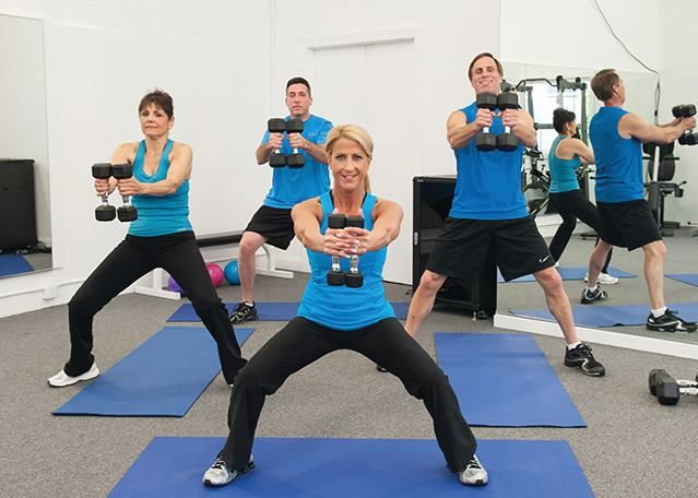 A metabolic must-have movement to help you get fit faster - Deep Squat to Front Raise > Stand with your feet shoulder-width apart with dumbbells in hands in front. Squat down and stand back up, raising dumbbells to chin level.