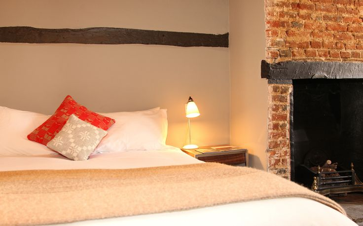Every bedroom at the Blue Boar, Witney has a Witney blanket on the bed for added cosiness