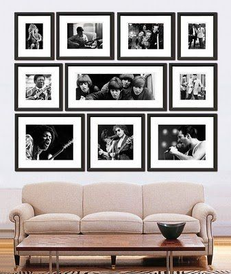 Love this photo display with simple black frames and white mattes. I enjoy how everything creates a square shape as a whole. My guess is there are two 5x7s, two 8x10s (or 8x12s), one 10×20, two 11x14s, two 10x10s, and one 12×12 or 14×14 in the bottom cent  | followpics.co