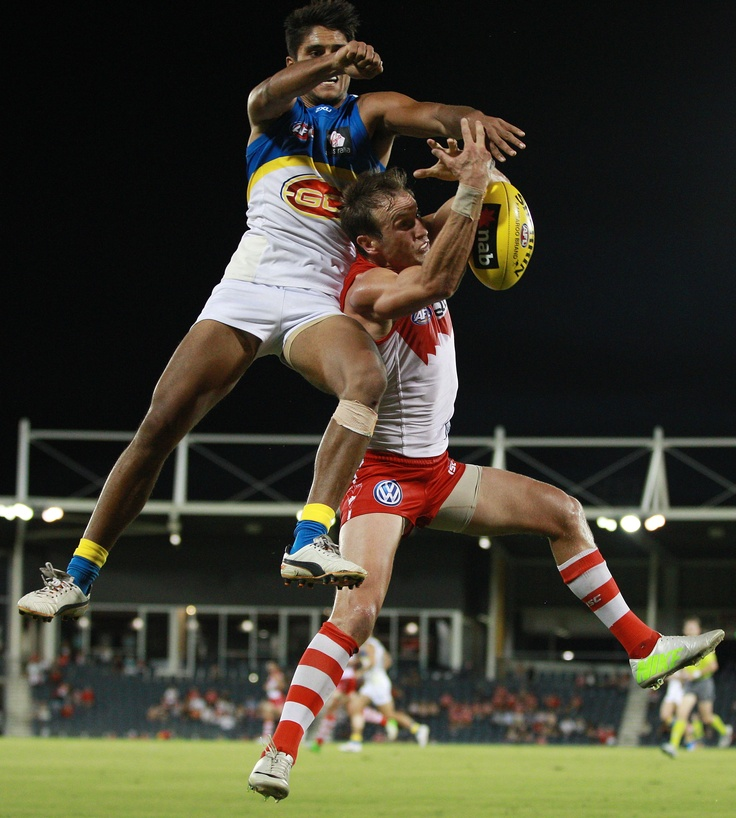 Jude Bolton of the Swans and Aaron Hall of the SUNS go up for a mark during the 2013 NAB Cup Round 3 match between the Sydney Swans and the Gold Coast SUNS at Blacktown International Sportspark, Sydney.