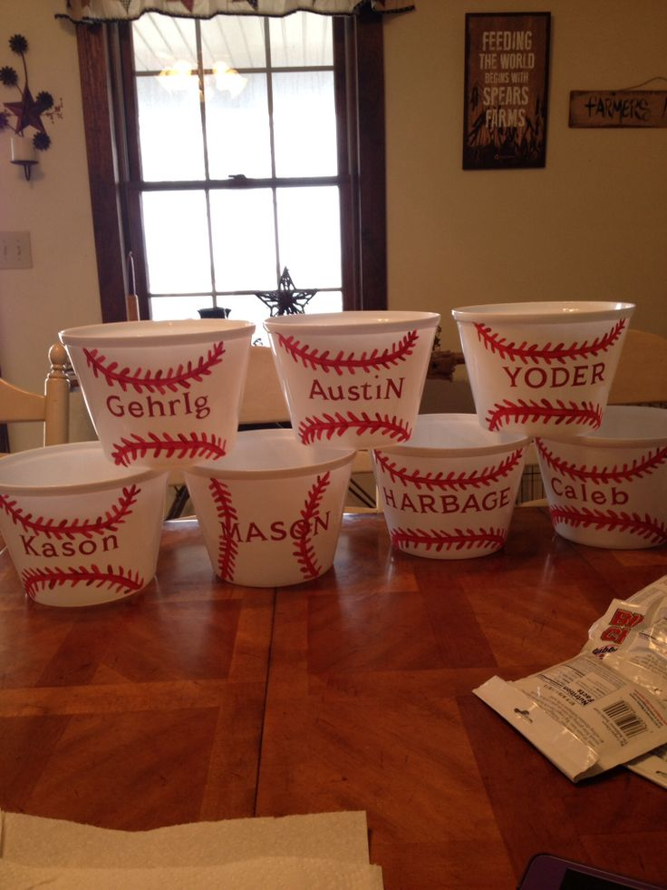 "Baseball gift buckets. Buy $ store bucket, apply letter stickers, and paint on baseball stitches!! Fill with Big League Chew, Sunflower seeds, and peanuts. ""batter up"""