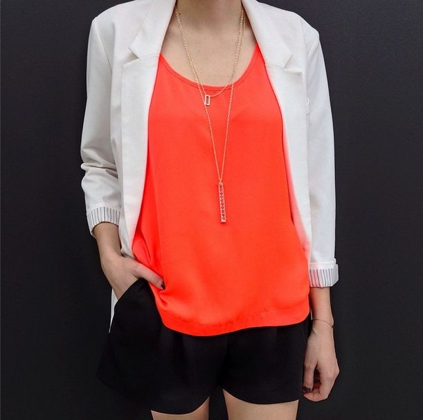 Add a pop of color to your summer wardrobe with this gorgeous tangelo tank!