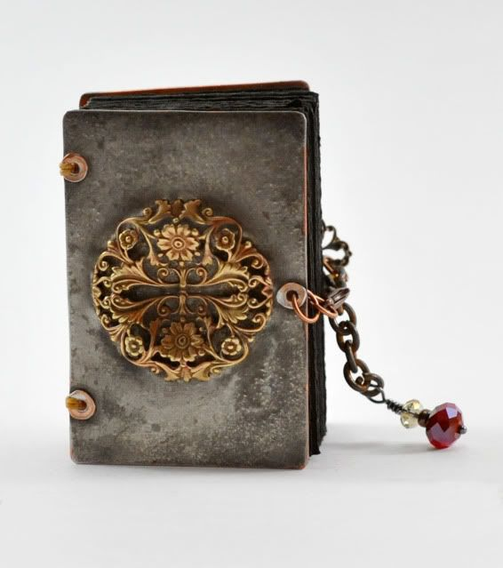 Coptic bound metal book.  This is inspiring!