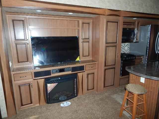 2016 New Forest River Cedar Creek 38CK Fifth Wheel in Arizona AZ.Recreational Vehicle, rv, 2016 Forest River Cedar Creek38CK, 12in Electric Slide Room A&E Awning, 13.5 BTU A/C, 20cu. Ft. Refrigerator, 30in Oven, 4 Steps at Entry Door, 50AMP Cord Reel, 6pt. Leveling System, Black Awning w/ Metal Shield, Carbon Monoxide Detector, Cedar Creek Explorer Package, Day/Night Roller Shades, Hathaway Package, HEAT PUMP ON MAIN A/C, La-Z Boy Furniture Package, Pearl Edition Walls and Cap, Rear Camera…