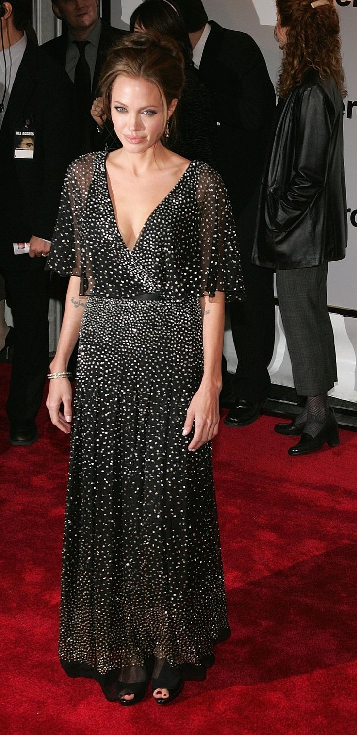 NEW YORK - DECEMBER 11:  Actress Angelina Jolie attends the World Premiere of 'The Good Shepherd' presented by Universal Pictures at the Ziegfeld Theatre on December 11, 2006 in New York City  (Photo by Bryan Bedder/Getty Images) via @AOL_Lifestyle Read more: https://www.aol.com/article/lifestyle/2018/01/10/angelina-jolies-complete-style-transformation/23330132/?a_dgi=aolshare_pinterest#fullscreen
