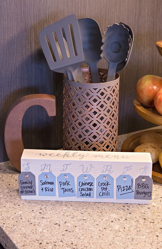 Make meal planning fun and simple with a DIY Menu Board. Paint a 2'x4' board, add days of the week, hammer in nails and punch out tags. Write your favorite meals on the tags, so you can quickly pick and choose your favorites for the week. Click in for the details.